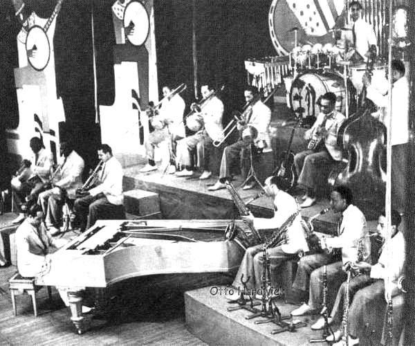 p. 104, Sur la scène du Palladium de Londres, 1933, X, Coll. Philippe Baudoin